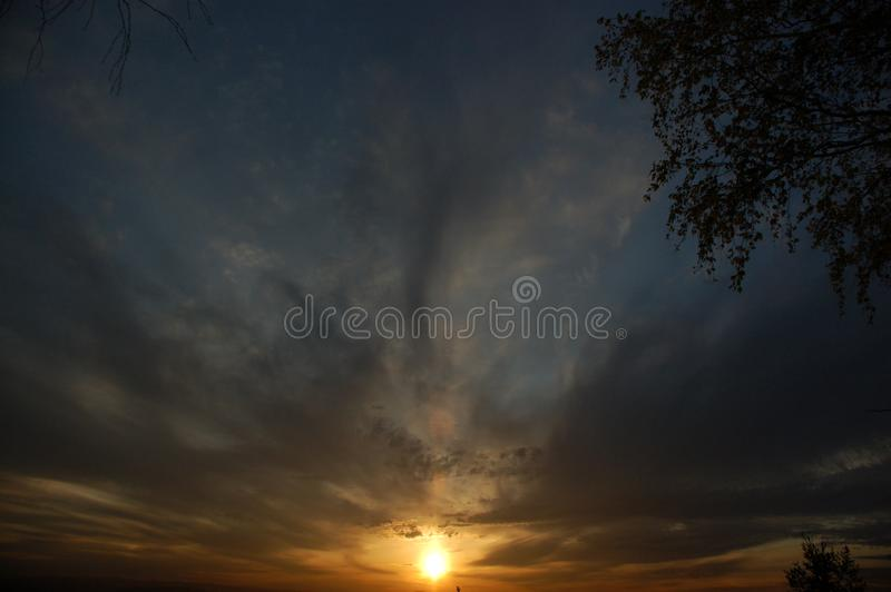 Sunset through the clouds royalty free stock photo