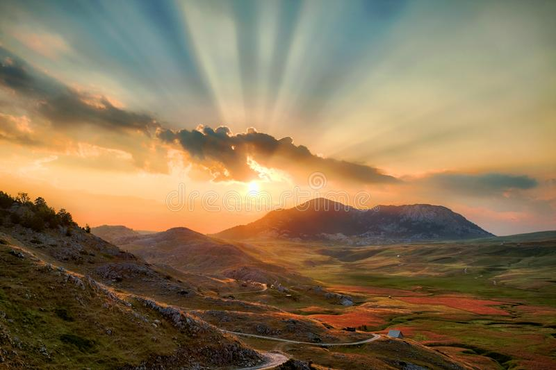 Sunset With Clouds And Light Rays On Highland In Montenegro. Colorful sunset with clouds and light rays on Lukavica Highland, Montenegro royalty free stock images