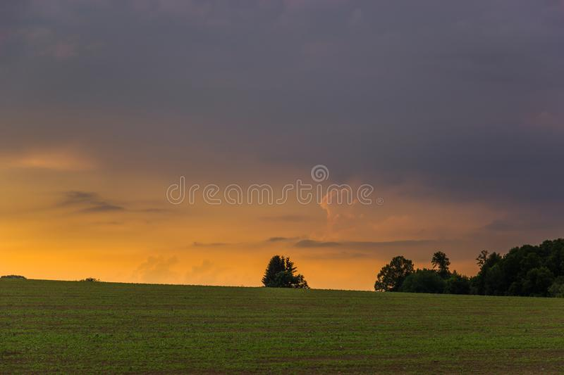 Sunset over czech countryside. Sunset with clouds over czech countryside stock photo