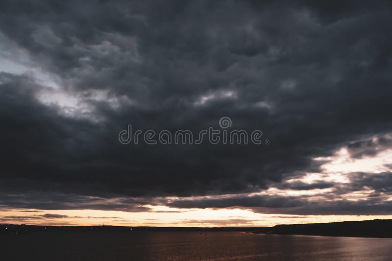 Sunset in the clouds over the lake royalty free stock images