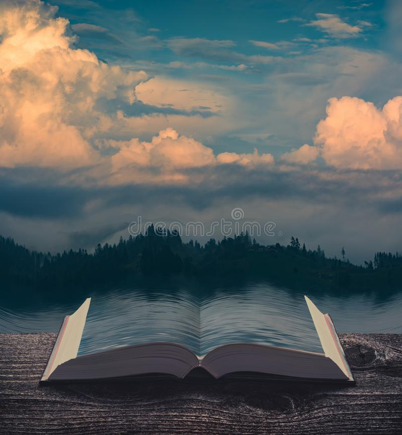 Sunset clouds over the lake on the pages of book stock images