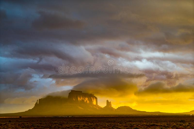 Sunset in thunderstorm, Monument Valley, Utah. Sunset through clouds over landscape of Monument Valley, Navajo Nation, Utah after thunderstorm stock photos