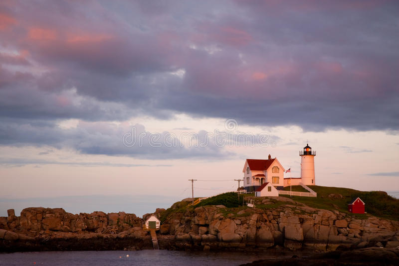 Sunset Clouds Over Nubble Lighthouse in Maine stock photos