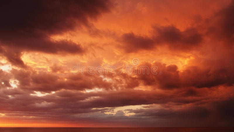 Sunset and red clouds. Over sea royalty free stock photo