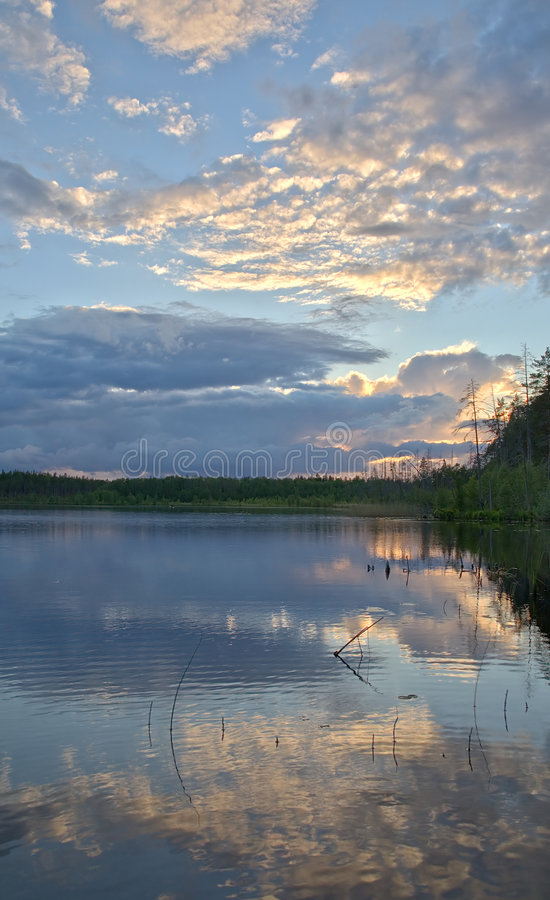 Sunset clouds reflection stock photography