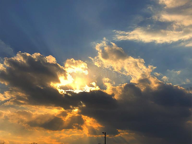 Sunset & clouds with sun beems stock image