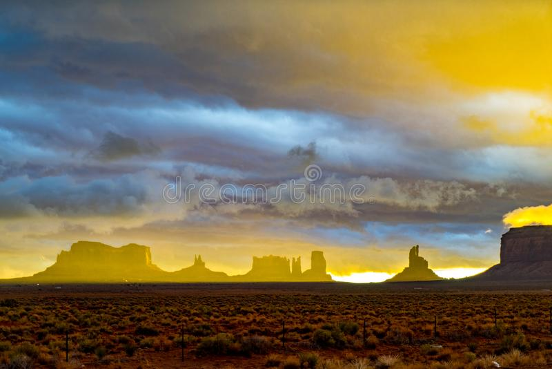 Sunset after storm, Monument Valley, Utah. Sunset through clouds after thunderstorm over rock formations of Monument Valley, Navajo Nation, Utah stock images