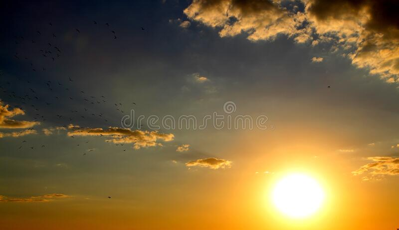 Sunset in cloudy skies royalty free stock images