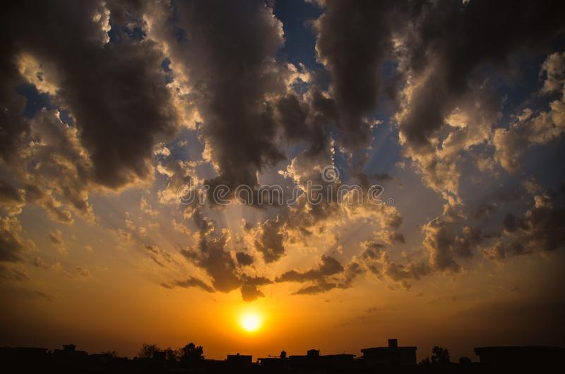 Sunset in cloudy skies royalty free stock photos