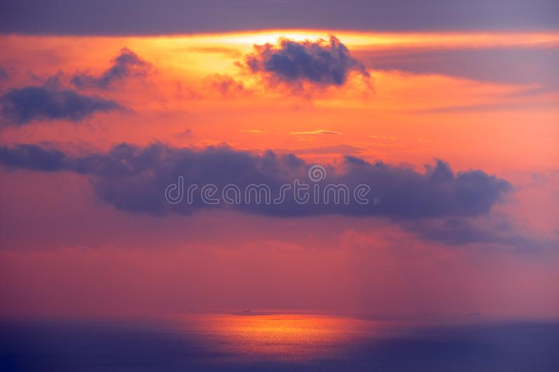 Sunset cloudy sky over ocean water. Landscape. stock photo