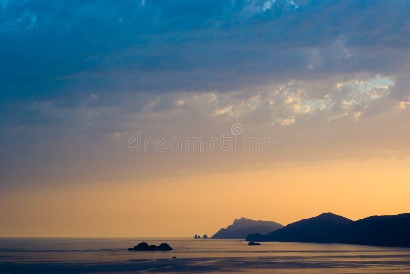 Sunset on the coast stock images