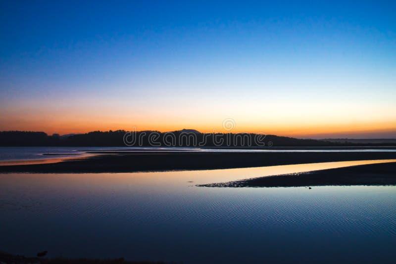 Sunset on the coast royalty free stock images