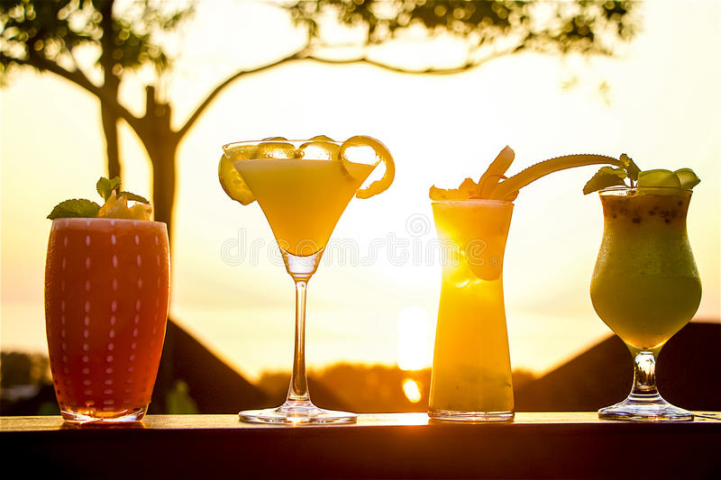 Sunset cocktails royalty free stock photos