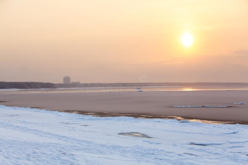 Sunset in cold foggy weather on Gulf of Finland, shore of sea royalty free stock image