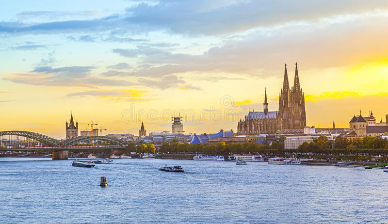 Sunset in cologne with Dome and river Rhine royalty free stock photos