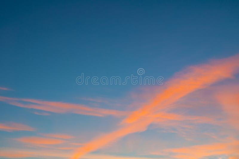 Sunset colorful sky background - orange dramatic colorful clouds lit by evening sunshine. Vast sunset sky landscape. Sunset colorful sky background - orange royalty free stock images