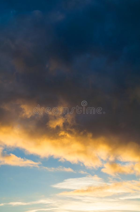 Sunset colorful sky background - pink, orange and blue dramatic colorful clouds lit by evening sunshine. Sky landscape. Sunset colorful sky background - pink royalty free stock photos