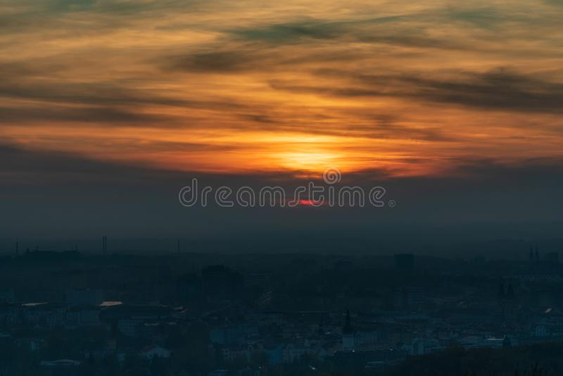 Sunset with colorful sky and clouds from Halda Ema in Ostrava city in Czech republic. During autumn stock image