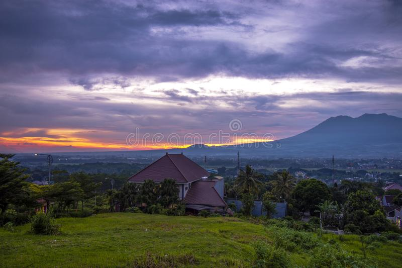Sunset with views of Malang Java city of Indonesia. Sunset Colorful sky with views of Malang Java city of Indonesia royalty free stock photos