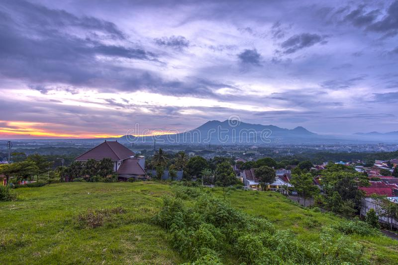 Sunset with views of Malang Java city of Indonesia. Sunset Colorful sky with views of Malang Java city of Indonesia royalty free stock photo