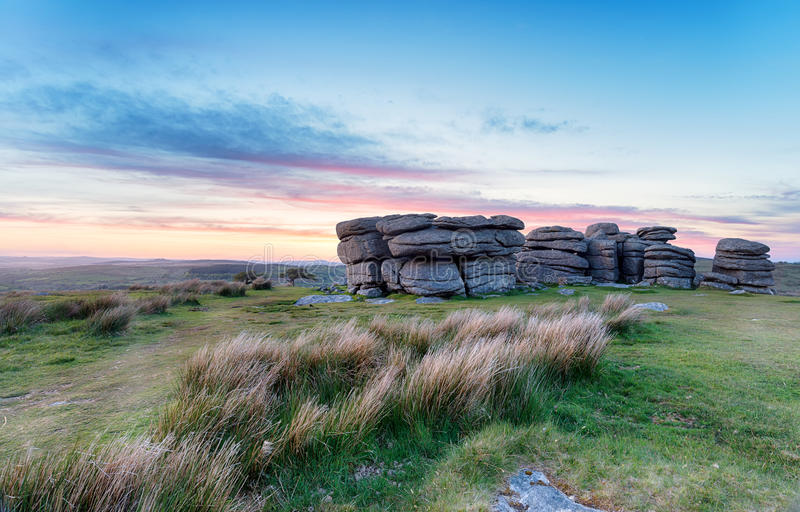 Sunset at Combestone Tor. Sunset over Combestone Tor near Yelverton on Dartmoor in Devon stock image