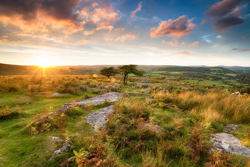 Sunset at Combestone Tor. Stunning sunset from Combestone Tor on Dartmoor in Devon stock images