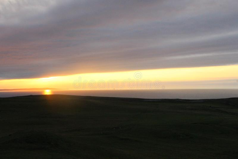 Sunset coming over the horizon stock photo