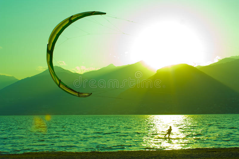 Sunset on como lake,kitesurf. 5th august 2010,lago di como(italia),shooting against the sun during sunset on the lake stock photography