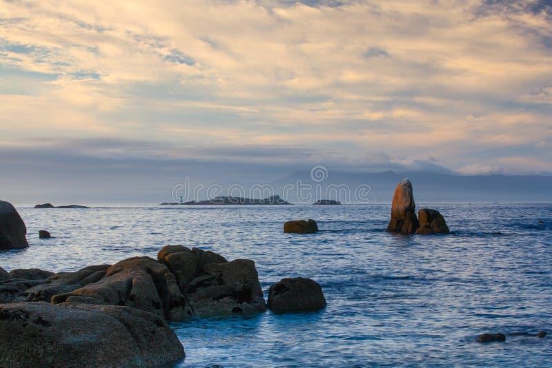 Sunset on Con Negro beach, de Pontevedra, Galicia, Spain. Coastal rocks on Con Negro beach stock photography