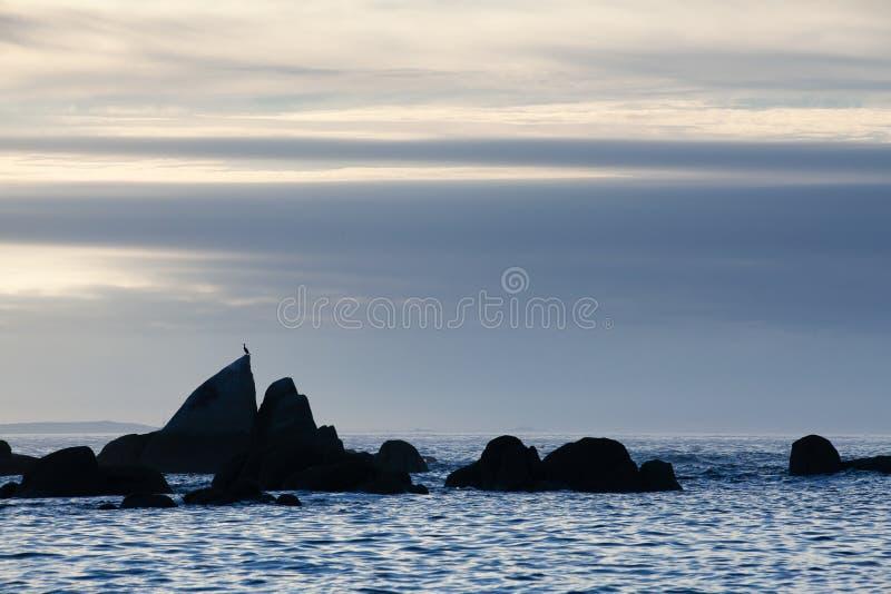 Sunset on Con Negro beach, de Pontevedra, Galicia, Spain. Coastal rocks on Con Negro beach royalty free stock images