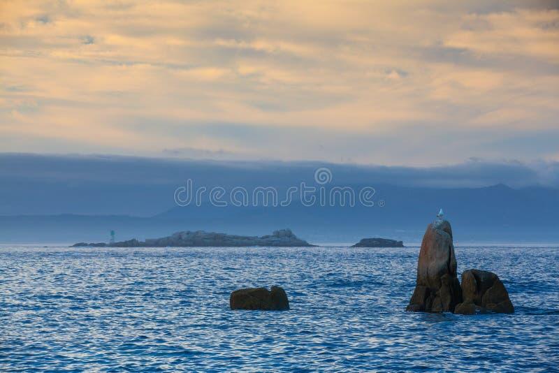 Sunset on Con Negro beach, de Pontevedra, Galicia, Spain. Coastal rocks on Con Negro beach stock photo