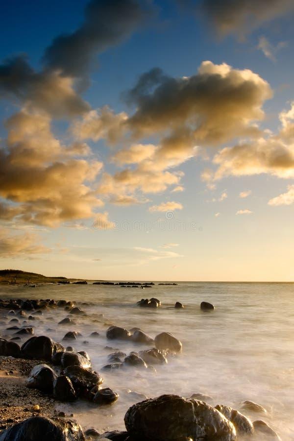 Sunset of coral reef coastline stock photo