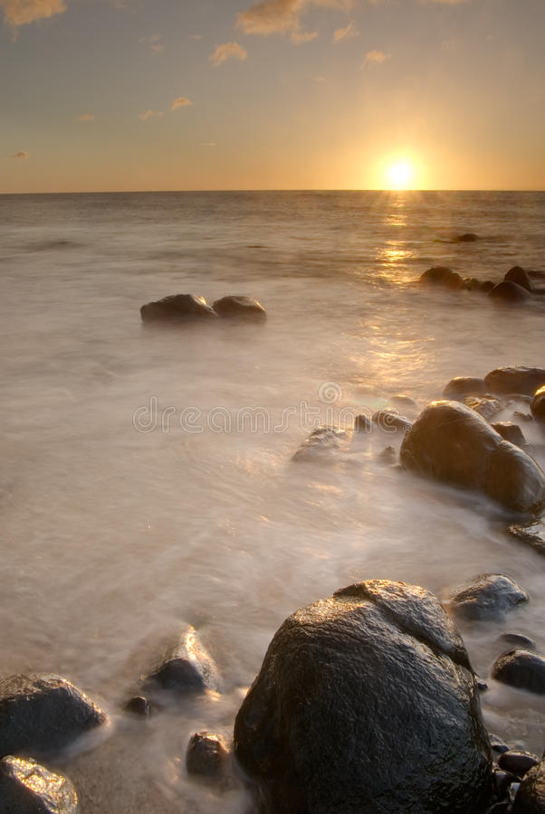 Sunset of coral reef coastline royalty free stock image