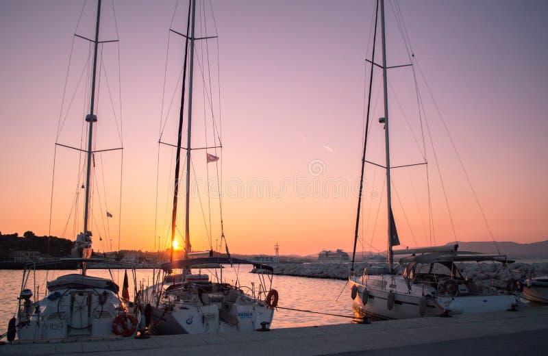 Sunset on corfu. Yachts royalty free stock images