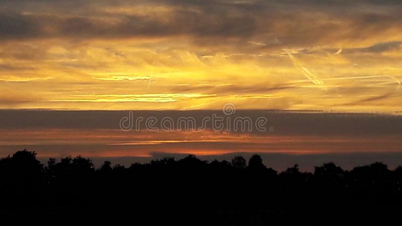 Sunset. With the coulds and trees shadows in the Netherlands royalty free stock photo