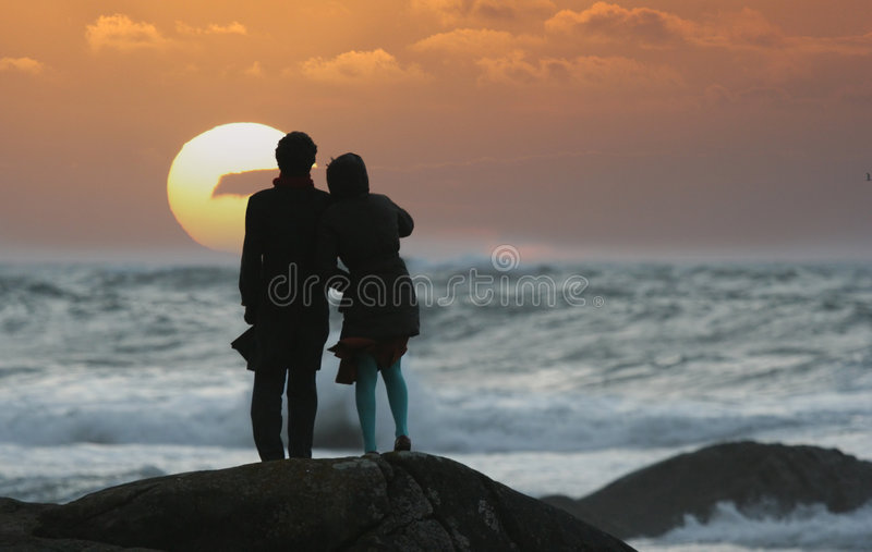 Sunset couple. Watching the sunset royalty free stock photography