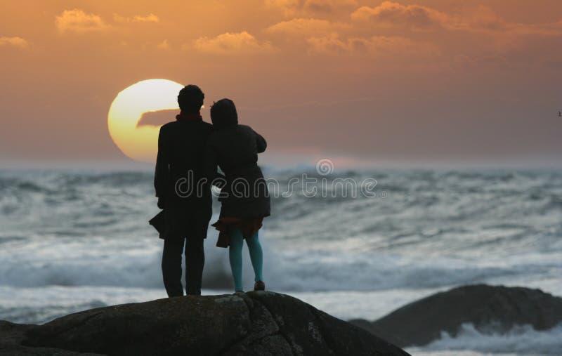 Sunset couple. Watching the sunset