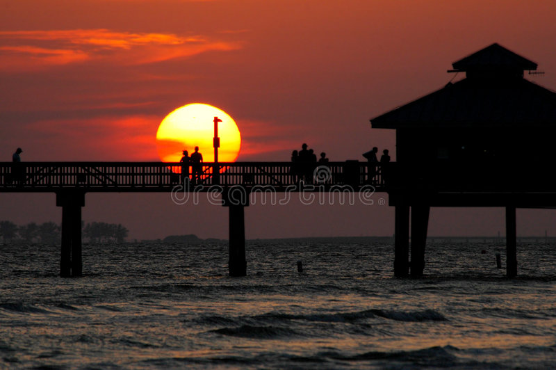 Download Sunset couple stock photo. Image of sunset, oceanside, silhouettes - 328408