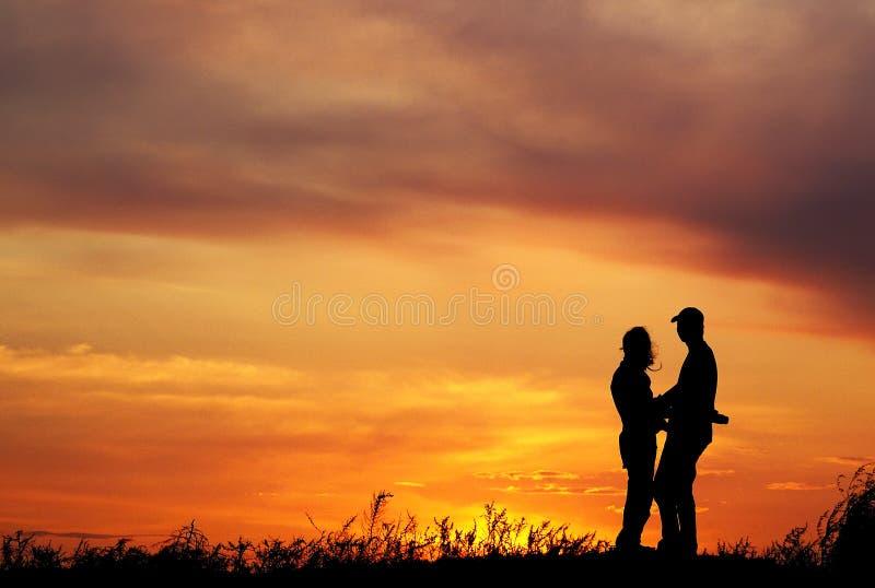 Sunset couples stock photos