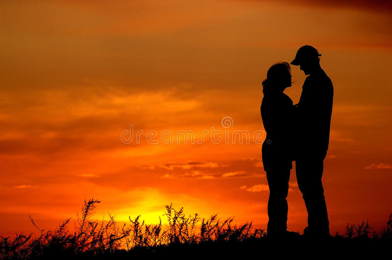 Sunset couples royalty free stock images