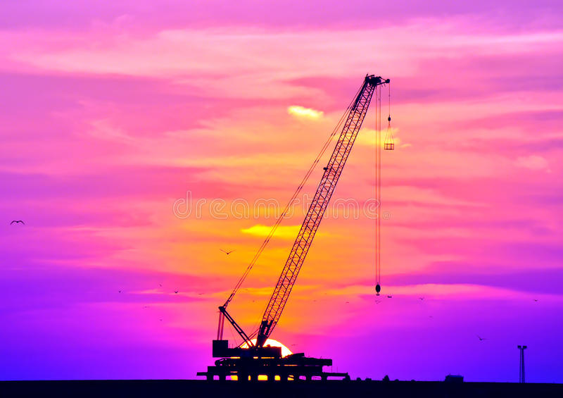 Sunset and crane
