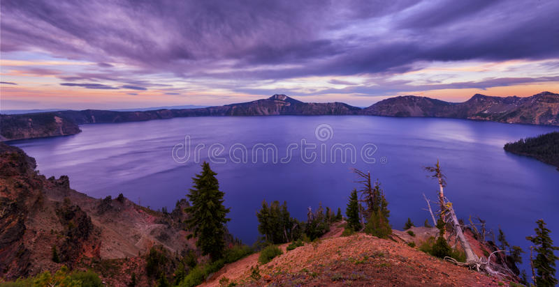 Sunset at Crater Lake. Crater Lake with its unique blue water is one of the most popular tourism attraction in Oregon state royalty free stock images