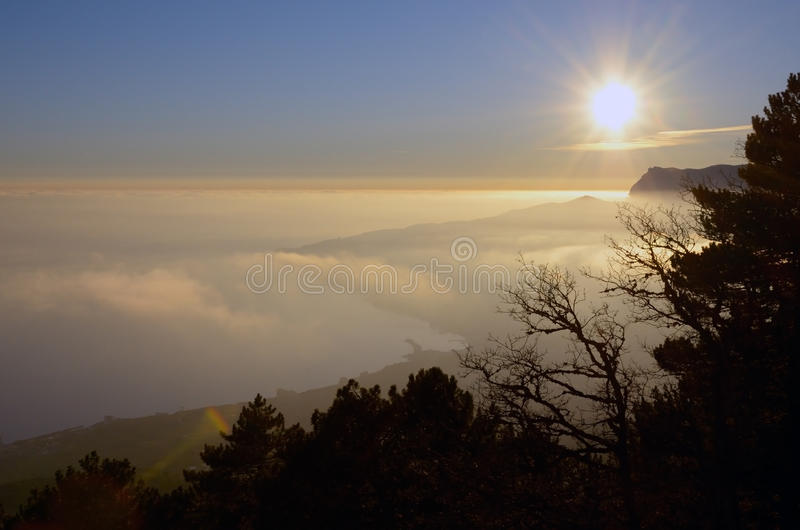 Background of sunset above coast in mountains stock photo