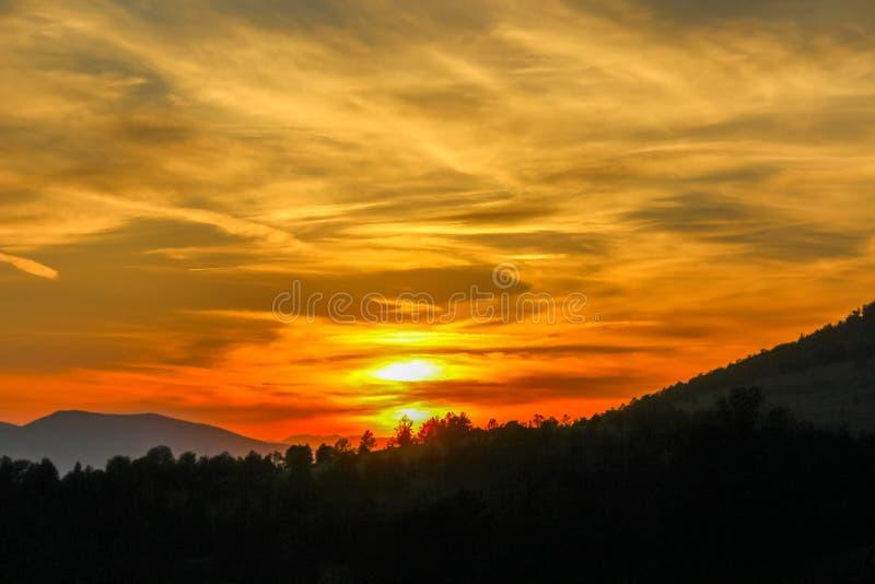 Sunset In Cripple Creek Colorado. Orange glow sunset over the mountains of Cripple Creek Colorado royalty free stock images
