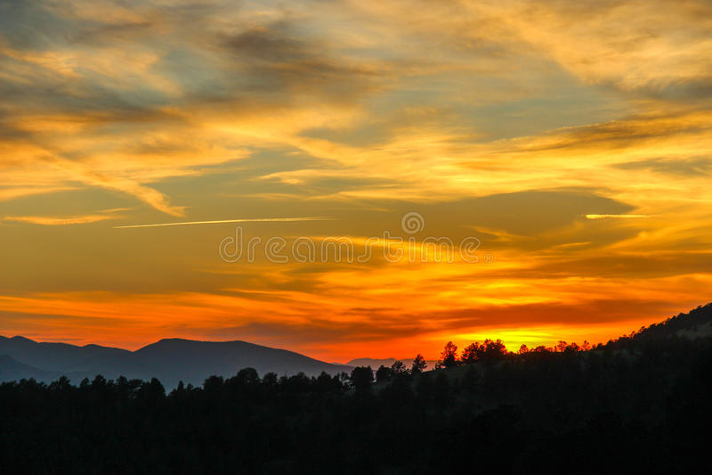 Sunset In Cripple Creek Colorado. Orange glow sunset over the mountains of Cripple Creek Colorado stock image