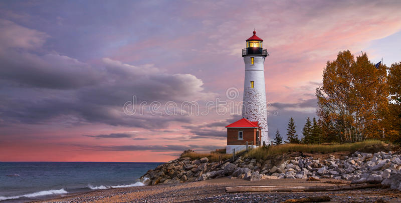 Sunset at the Crisp Point Lighthouse. As daylight begins yielding to twilight, The Crisp Point Lighthouse at sunset on Lake Superior, Upper Peninsula, Michigan royalty free stock photos