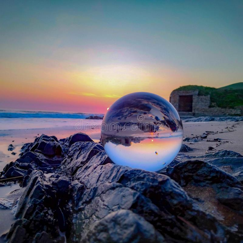 Sunset in a crystal ball stock images