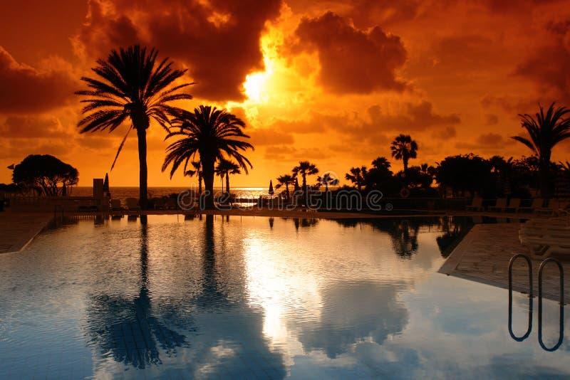 sunset on cyprus resort stock photos