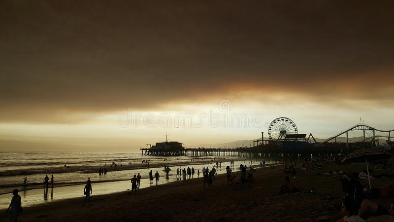 Beach at Sunset with Dark Cloud Cover stock photography