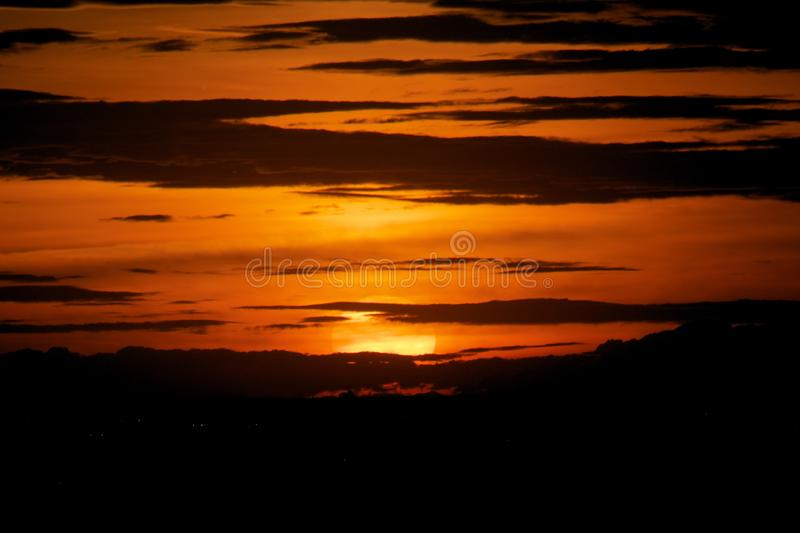 Sunset in darkness cloud background royalty free stock photos